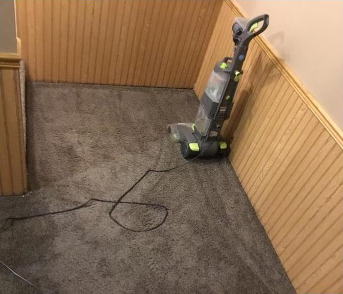 Wet carpeted floor before water mitigation.