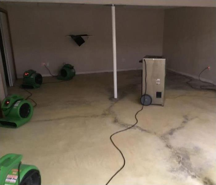 Equipment placed for the drying of the concrete floor in this basement.