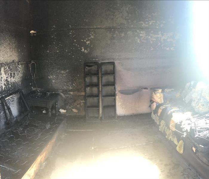 After burning, the couches and other wood structures are reduced to ash.