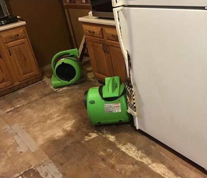 Tiles removed and there are air movers placed for dying.