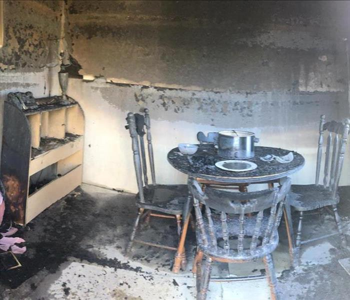 Post burning; the entire simulation structure including the furniture is charred on the inside.