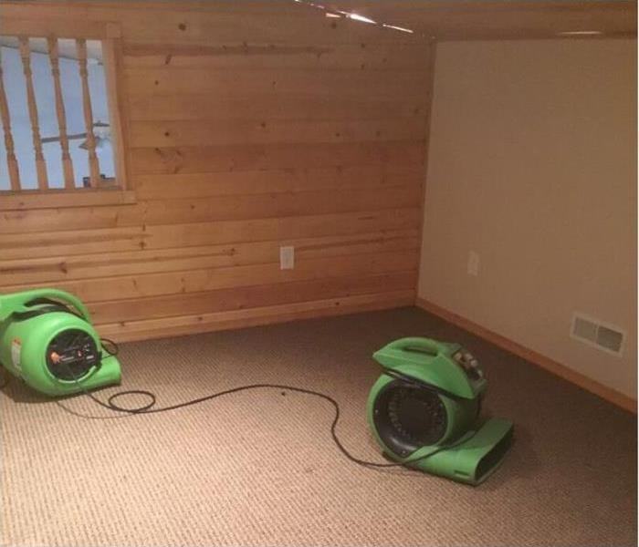 Air-movers placed to dry the carpet