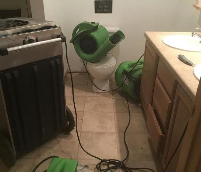 Air movers placed throughout the room during the drying process.