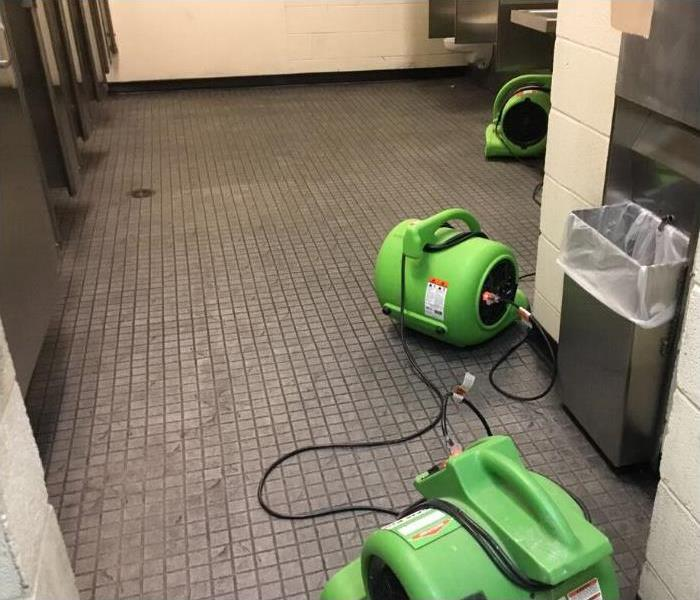 Men's room, water extracted, air movers placed for drying.