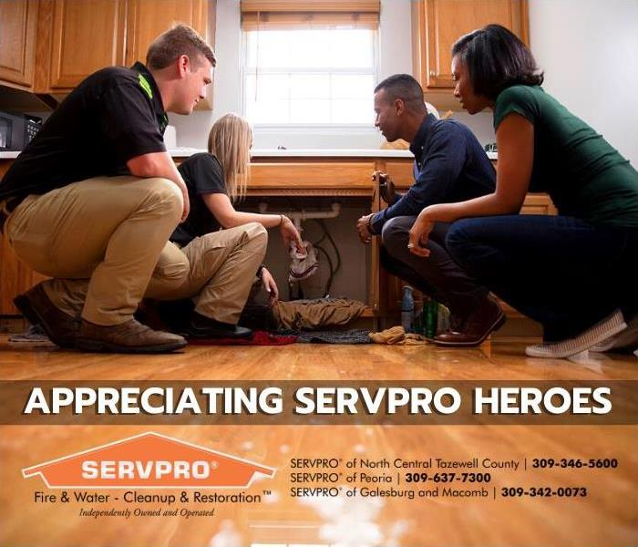 Title Card - SERVPRO Employees explaining something to a customer